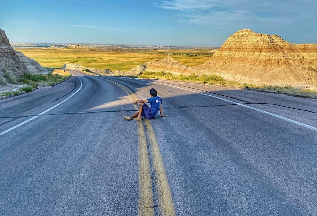 Trin on the road in the badlands