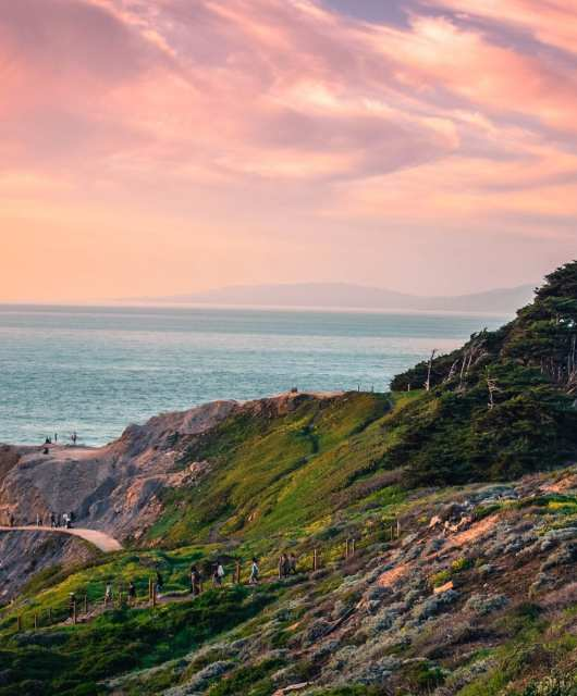 Soothing pink and orange skies from Lands End. Photo: Kavi Sharma (@its_kavi_doe), #SFGuide Featured Photographer.