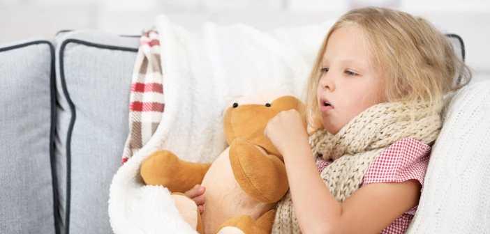 little-girl-coughing-holding-her-teddy-bear