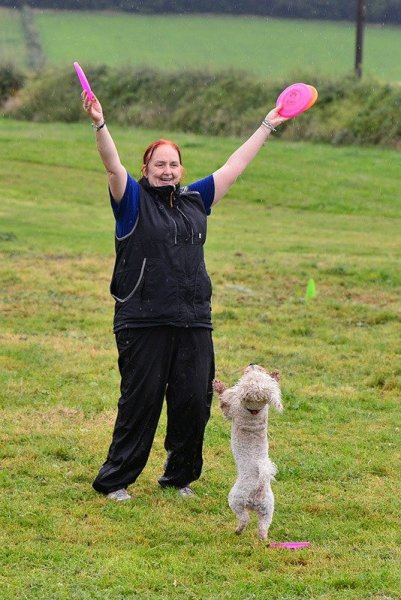 Heather Smith training disc dog with her small dog