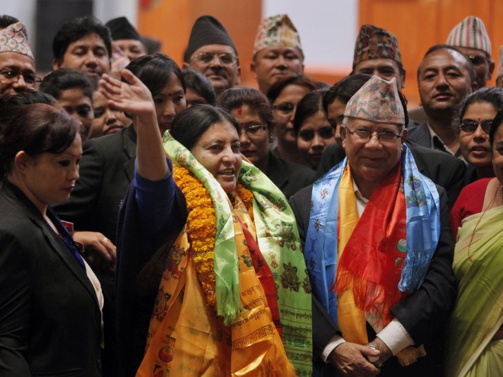 Bhandari (center) celebrates Wednesday in Kathmandu after she was elected to be Nepal's new president.