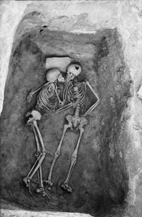'The Lovers' from 1972 season at Hasanlu Hasanlu is an archaeological excavation site in Iran, Western Azerbaijan, Solduz Valley. Theses skeletons were found in a Bin with no objects. The only feature is a stone slab under the head of the skeleton on the left hand side.