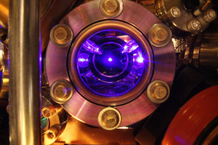 Strontium atoms floating in the center of this photo are the heart of the world's most precise clock. The clock is so exact that it can detect tiny shifts in the flow of time itself. Courtesy of the Ye group and Brad Baxley/JILA