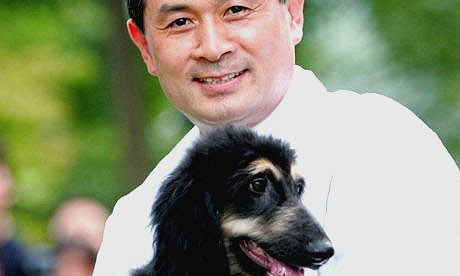 South Korean stem cell researcher Hwang Woo-suk holds Snuppy, the first successfully cloned dog. Photograph: Ahn Young-joon/AP