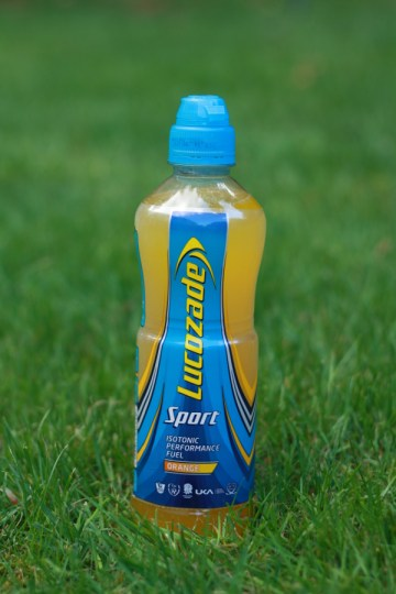 Lucozade Sport Orange Bottle on grass