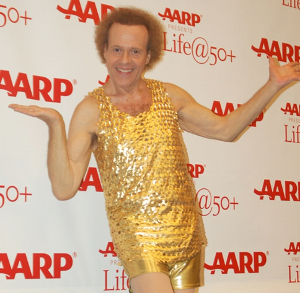 Why can't he just dress like everyone else for once? It's like having Richard Simmons turn up each week.