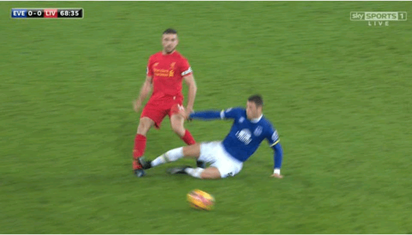 Professional Football Ankle Injury Tackle