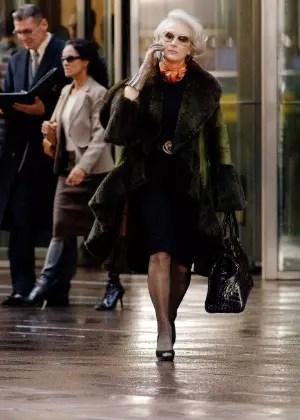 No papel de uma editora de moda, em O Diabo Veste Prada