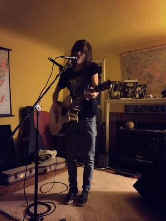 Val Bauer performing at a Damn House Show