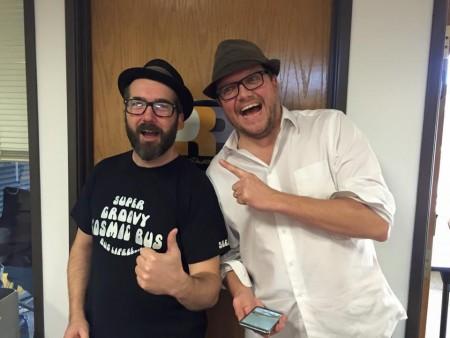 Sam Densmore in a bus t-shirt with Eric John Kaiser