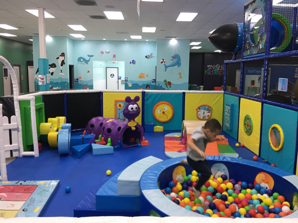 Jace jumping into ball pit in Crawler Zone