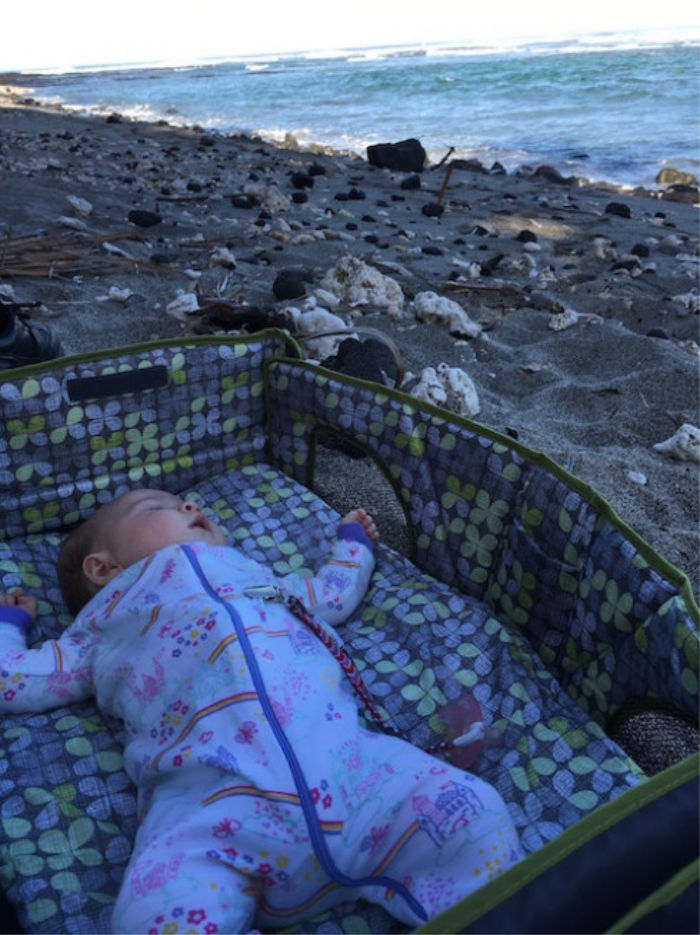 Baby napping on the beach