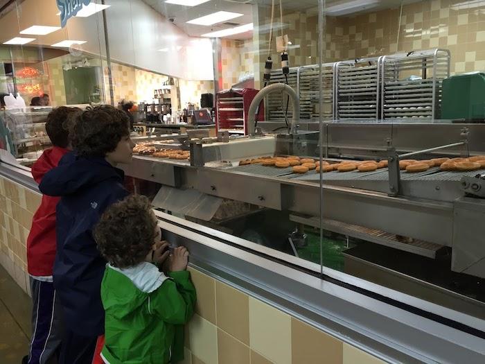 Watch the Krispy Kreme donut production line up close