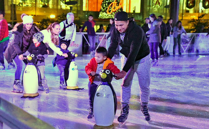 ice skating children in the evening