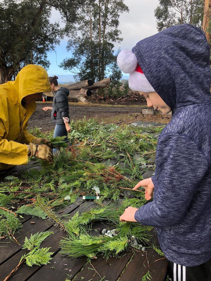 Rancho Siempre Verde kid making wreath