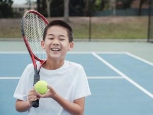 tennis playing kid