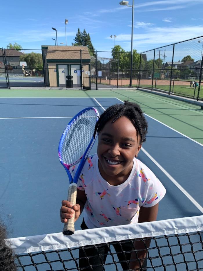 jax playing tennis