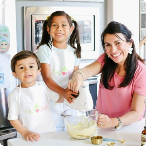 Kids cooking with Raddish kits and mom