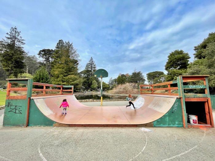 little kids running on skate ramp