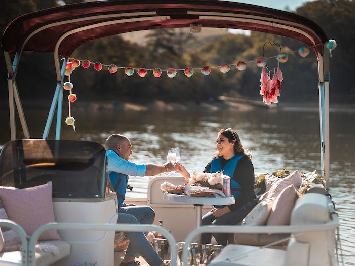 Two adults on a romantic pontoon at Lake Chabot