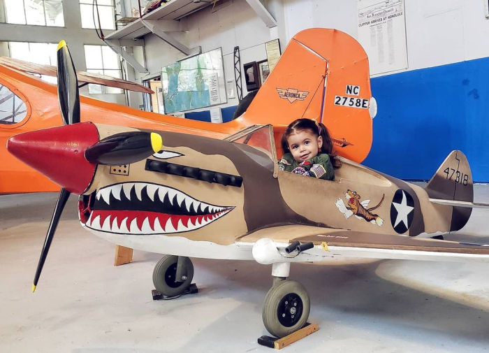 child in fighter plane