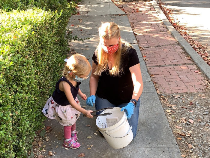 mom and daughter pick up trash plog