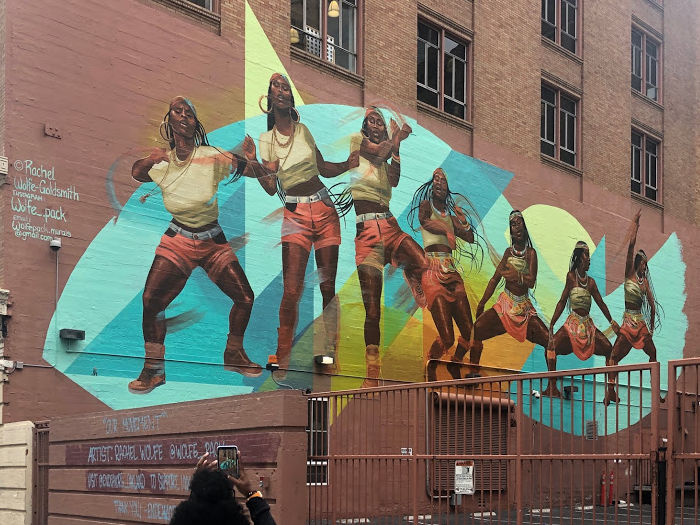 wall mural of a woman dancing through time in oakland