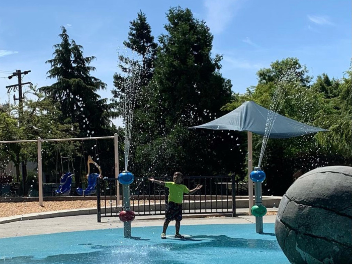 Castro Valley Park Splash Pad with child