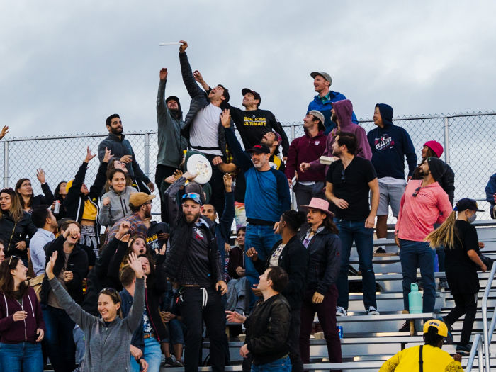 fans at ultimate frisbee game