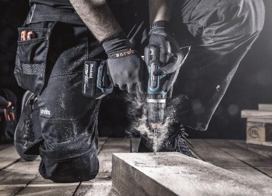 Man drilling wearing Scruffs Gloves