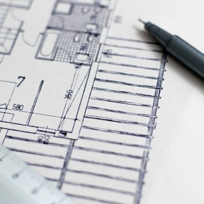 architects drawing of a blueprint with pen and ruler