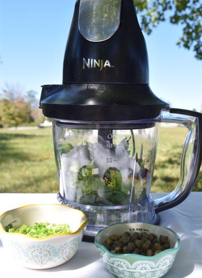 ninja mixer with salsa ingredients inside