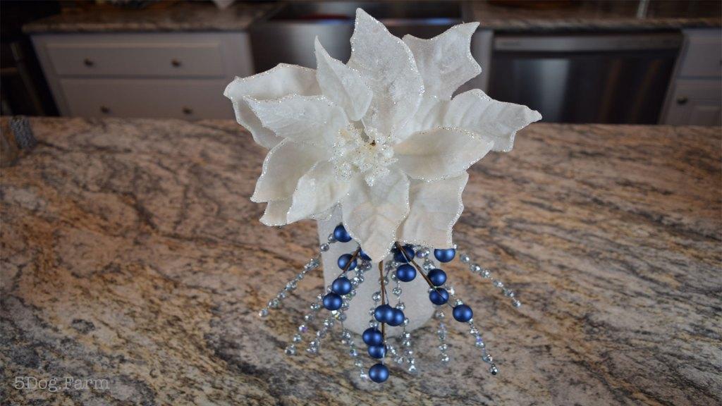 white flower in diy glitter candle jar