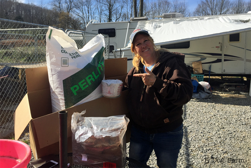 big bag of perlite with woman standing next to it