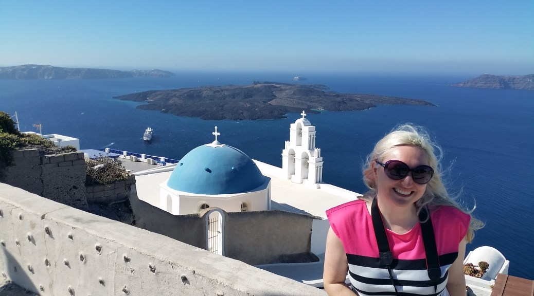 Woman with camera in front of Santorini church overlooking the ocean, absolute novelty