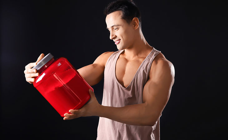 Man Looking Protein Powder