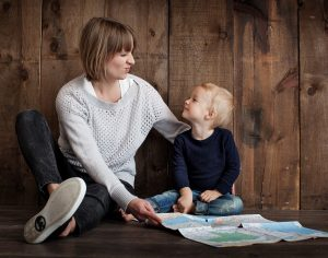 Mom and little boy reading a map #5SLL #5sensesLL #normalisoverrated #homeschool #homeschoolkindergarten #homeschoolpreschool #specialneedshomeschooling #neurodiversehomeschooling