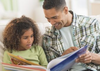 Father reading picture book to child #5SLL #5sensesLL #normalisoverrated #homeschool #homeschoolkindergarten #neurodiversehomeschooling #adhdhomeschooling