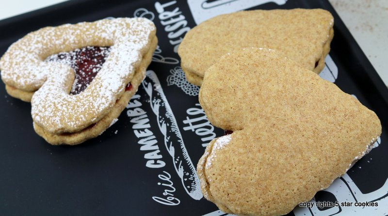 Raspberry Cookie Sandwiches from the best food blog 5starcookies - add whole wheat organic flour and mix well-dust with icing sugar and enjoy