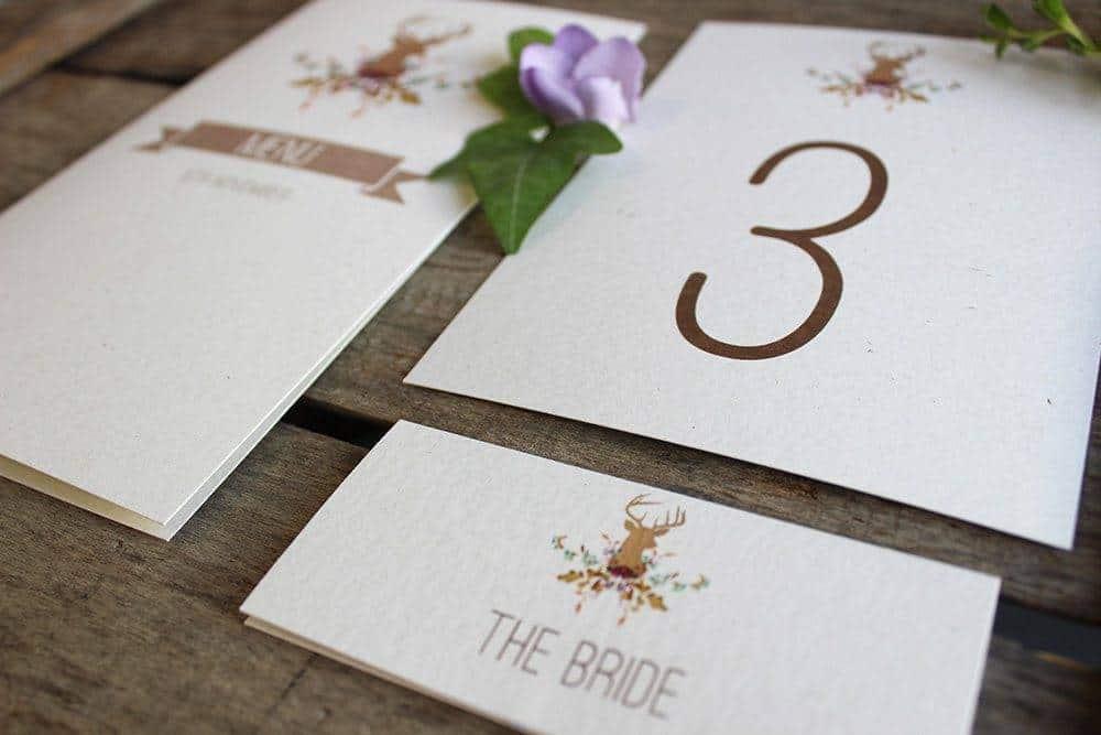 Ivy Ellens Fauna Wedding Stationery Flat Lay Angle