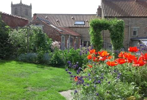 Enjoy the cottage garden flowers from a hammock!