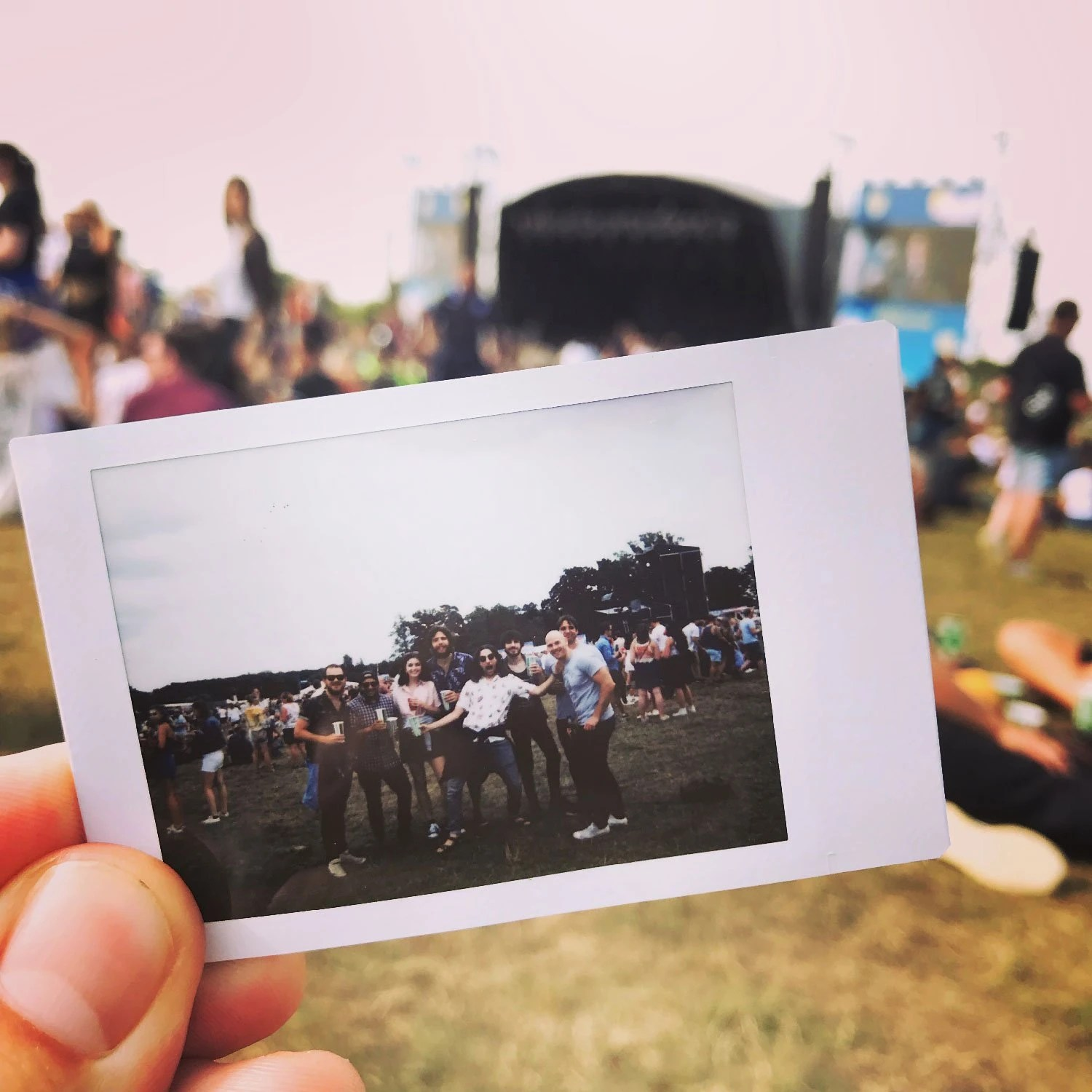 6rs team at rise festival on a polaroid photo