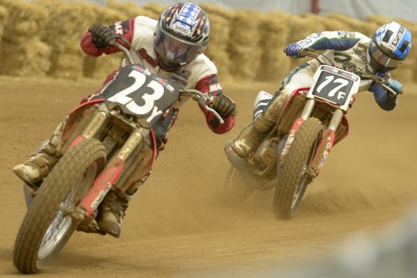 AMA Pro Flat Track riders sliding through a turn