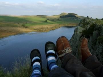 K and M's feet overlooking Hadrian's Wall