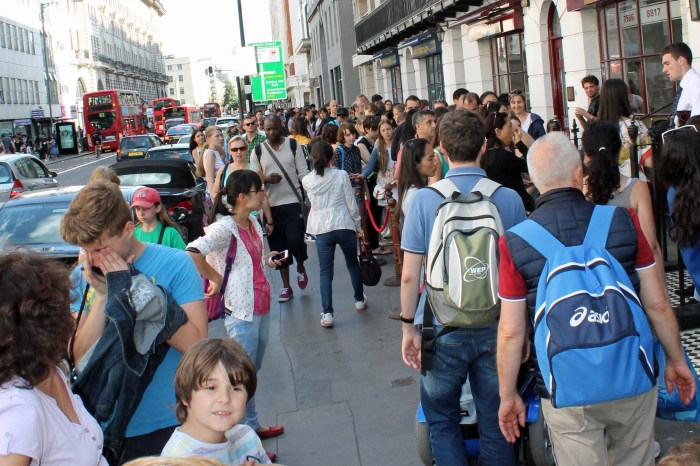 A long line of people stretches down Baker Street as far as you can see