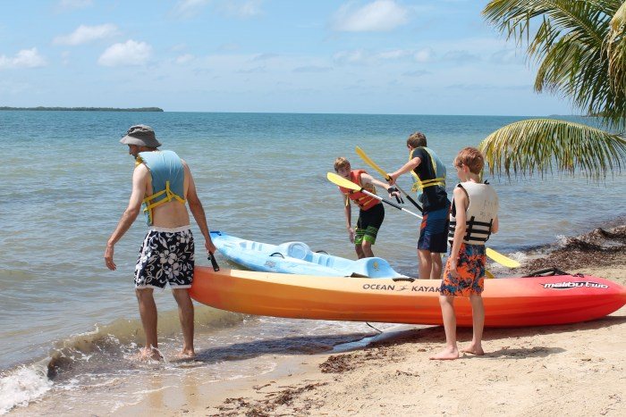 The author's family launches kayaks from the beach