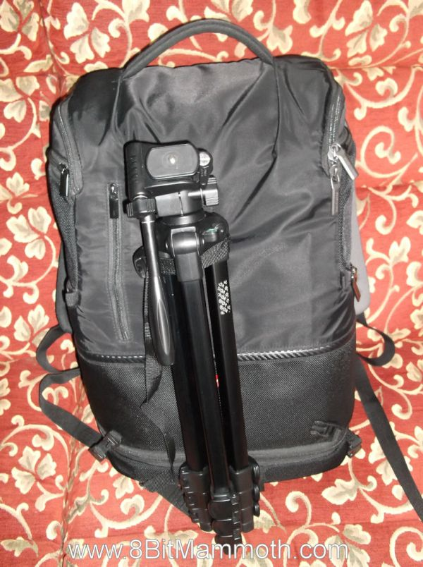 A backpack with a camera tripod attached
