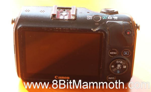The rear of a dirty Canon EOS M camera
