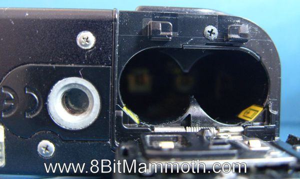 A photo showing the battery compartment on a Sony Cyber-shot DSC-W12 camera.