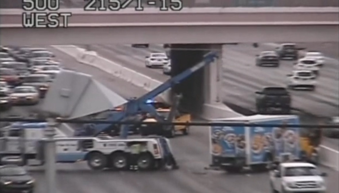 TRAFFIC ALERT: Flipped over truck stalls traffic on 215 eastbound at